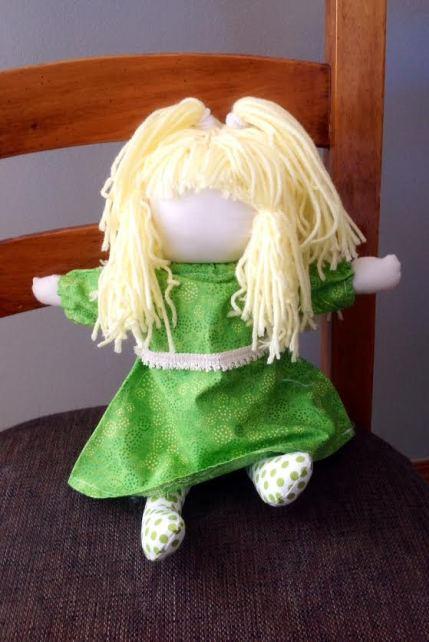 green doll
